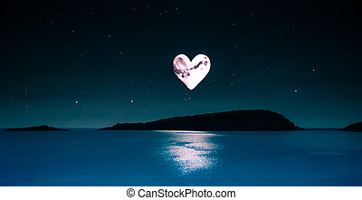 romantic picture of a heart-shaped moon over a calm sea -...