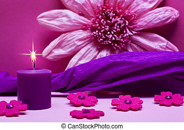 pink background with flowers and candle