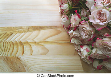 romantic pink bouquet of roses on wooden background