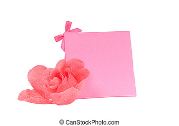 Romantic pink gift card and a flower isolated on white background