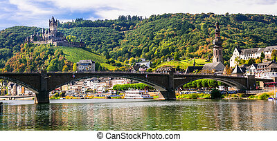 Romantic river Rhein - medieval Cochem town. View of bridge...