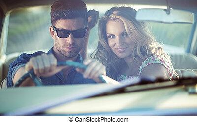 Romantic scene inside the retro car