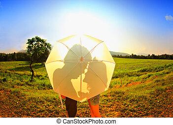 Romantic scene of love the shade of umbrella white.