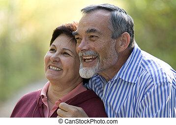 romantic senior couple - Happy elderly couple embracing...