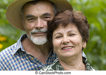 Happy elderly couple embracing outdoors
