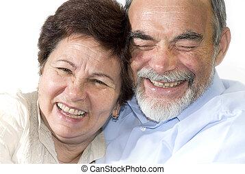 senior couple laughing - romantic senior couple laughing