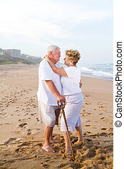 romantic senior couple on beach