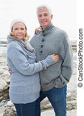 Romantic senior couple on rocky beach