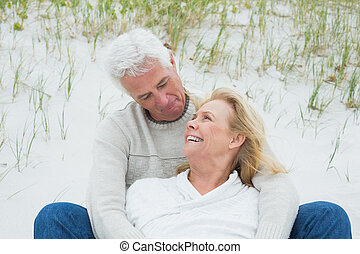 Romantic senior couple relaxing at beach