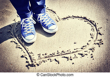 Romantic setting with heart sign on the beach