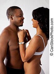 Romantic, sexual black couple