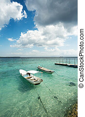 Small boats on nusa penida beach, Bali Indonesia - romantic ...