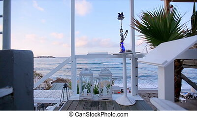 Romantic stay at the hotel located on the beach. View from the hotel terrace to the sea