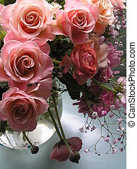 still-life photograph of a wonderful romantic bouquet with champagne colored roses in a vase