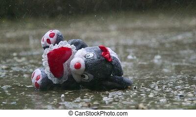 Romantic stuffed toy lost in the rain