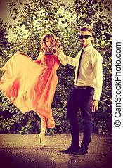 romantic summer - Beautiful fashionable couple standing ...