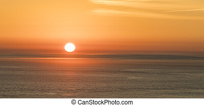 romantic sunset at the atlantic ocean seen from Gay Head cliffs at the westernmost point of Martha's Vineyard in Aquinnah