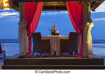Romantic sunset dinner at the beach
