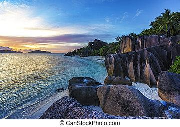 romantic sunset in paradise, anse source d'argent, la digue, seychelles 3