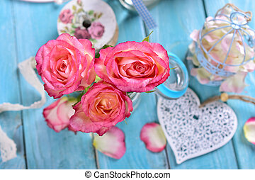romantic table decoration with pink roses and white heart
