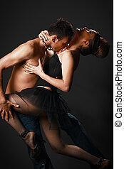 romantic tango dancing couple on black