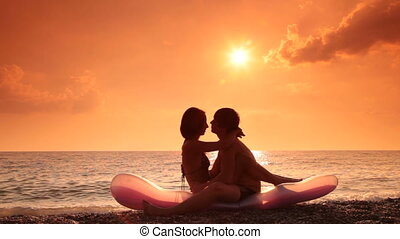 Romantic teen couple on the beach