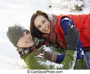 Romantic Teenage Couple Having Fun In Snow