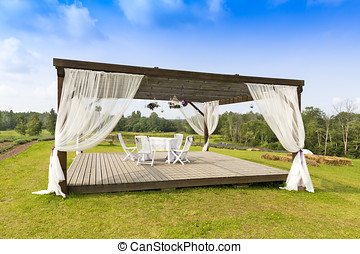 romantic tranquil scene with pergola on the hill
