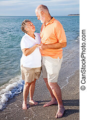 Romantic senior couple on a seaside vacation at the beach.