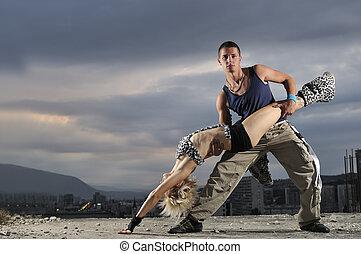 romantic urban couple dancing outdoor