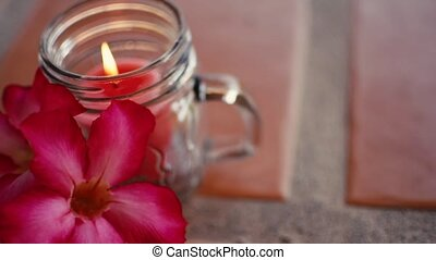 Romantic Valentine's Day Candle and flowers. Beautiful love scene. Date, Dinner, table setting in restaurant. Full HD 1080p