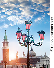 romantic views with ancient pink lantern in front of the Basilika San Giorgio Maggiore in Venice, italy