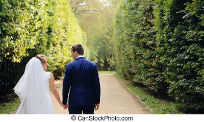 Romantic Wedding Concept Bride Holding Hand Walking shot in slow motion  close up