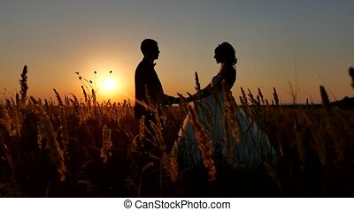 Romantic wedding young couple silhouette. loving couple at sunset man and girl silhouette nature