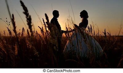 Romantic wedding young couple silhouette. loving couple at sunset man and girl silhouette
