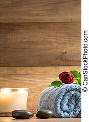 Romantic wellness arrangement with a burning candle
