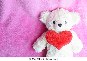 Romantic with teddy bear and red heart on pink backgrounds