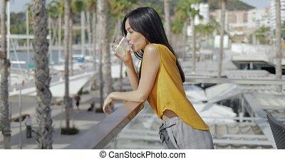 Romantic woman enjoying resort - Young confident model in...