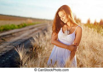 Romantic woman in fields of barley
