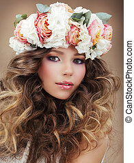 Romantic Woman in Wreath of Flowers with Perfect Skin and Frizzy Hair