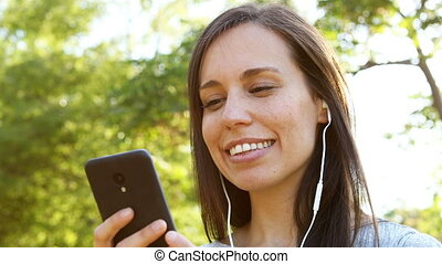 Romantic woman listening to music on phone - Romantic adult...