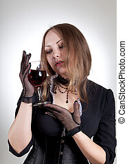 Romantic woman with glass of wine