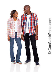 young african american couple holding hands