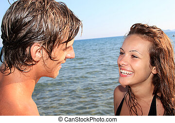 Romantic young couple by the sea