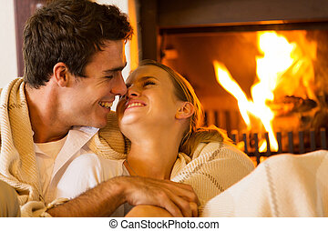 young couple cuddling - romantic young couple cuddling on...