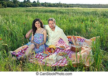 Romantic young couple enjoying a picnic