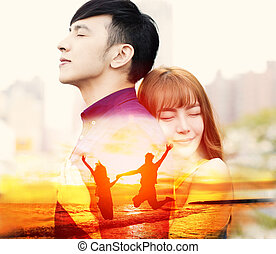 romantic young couple hugging and jumping on the beach concept