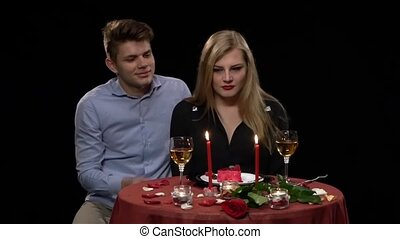 romantic young couple in love on a date sitting in a cafe, Slow motion