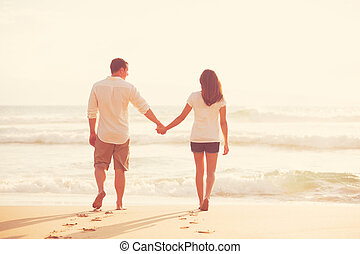 Romantic Young Couple on the Beach at Sunset
