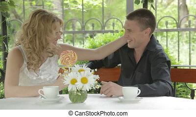 Romantic young couple tasting big l